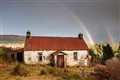 Rainbow over decaying croft house, North West Scotland