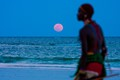 Red Moon rising from the Indian Ocean