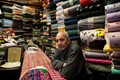 A man who sells textiles in an old part of Cairo