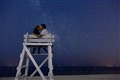 Kissing on the beach at night