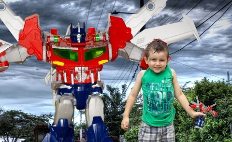 Transformer toy being big and grab a kid