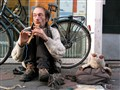 flute playing beggar on the street, Amsterdam