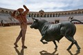 Composite of three images: empty bullring at Antequera, and two separate sculptures in Cordoba. Shadows added.