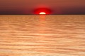 The sun sinks under Lake Michigan