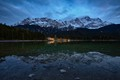 Reflection of Germany's highest mountain, the Zugspitze, in lake Eibsee after sunset.