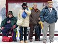 Light snowfall at the bus stop